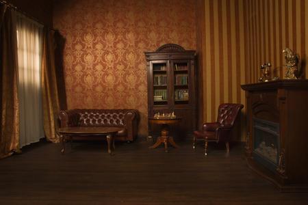 Foto de Classical library room with leather armchair, wooden table and bookcase - Imagen libre de derechos