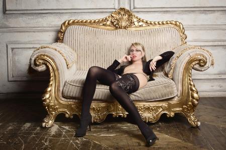 Photo pour Sexy half-naked woman in glasses and business suit. Erotic concept   - image libre de droit