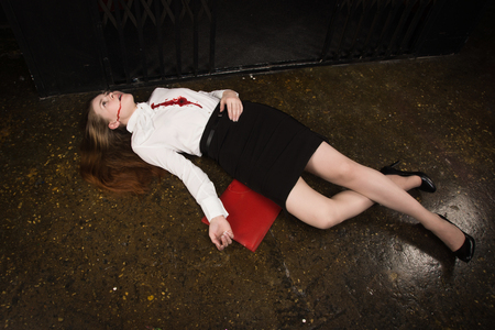 Photo for Crime scene. Business woman shot in the chest in old elevator - Royalty Free Image