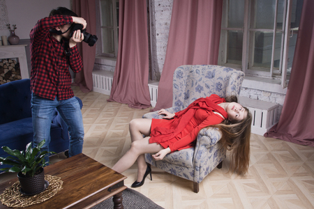Photo for A man photographer takes pictures of a crime scene with a young woman - Royalty Free Image
