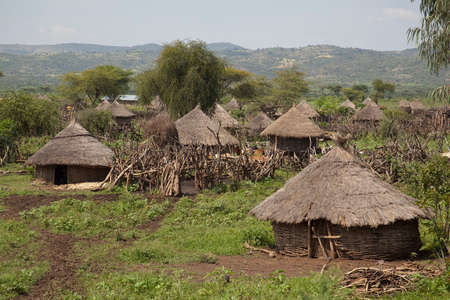 Photo pour View of an African village with small huts - image libre de droit