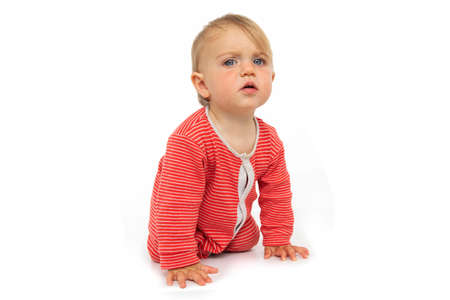 Photo pour Adorable blue eyed baby with in red romper crawling on all fours and looking at camera in surprise on white background - image libre de droit