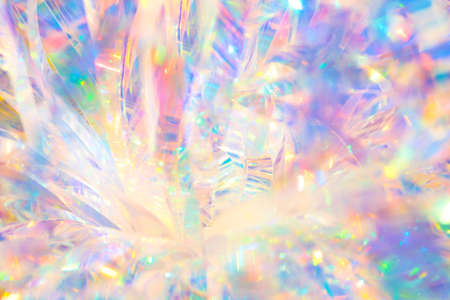 Photo for Abstract radiant festive merry holiday backdrop texture image of holographic iridescent metallic foil ribbon decoration with warm bright glow and sparkling crystal ice reflections and bokeh light - Royalty Free Image