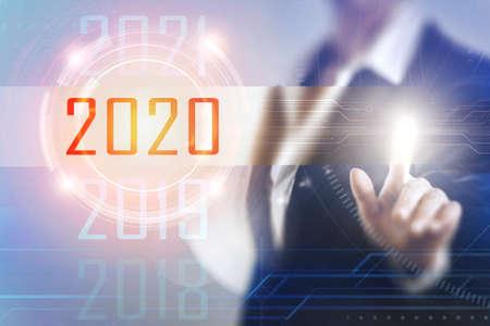 Photo pour Business women touching the 2020 screen - image libre de droit