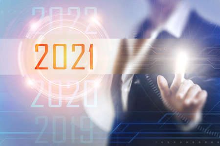 Photo pour Business women touching the 2021 screen - image libre de droit