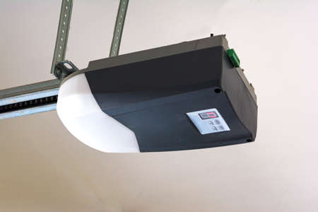 Photo pour Close-up of an automatic garage door opener motor. - image libre de droit