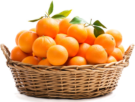Photo pour A wicker basket full of fresh orange fruits, isolated on a white background.  - image libre de droit