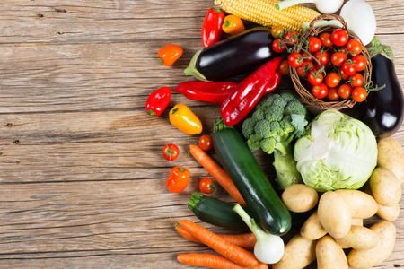 Vegetables on wood background with space for text, top view. Organic food.