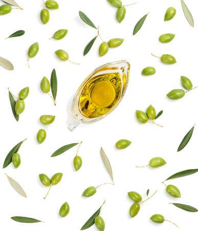 Photo for Green olive fruits with leaves and olive oil isolated on white background, top view. - Royalty Free Image