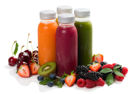 Foto de Variety smoothies, juices, beverages or drinks with fresh fruits and berries isolated on white background. - Imagen libre de derechos