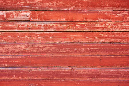 Photo pour Old wooden background painted with red paint with a texture of cracks and scratches. Red background - image libre de droit