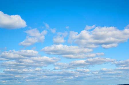 Photo for Wavy, porous curly clouds on the blue sky. Nature background. - Royalty Free Image