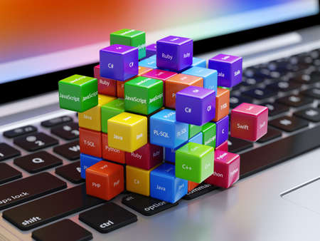 Photo for Programming concept. Different machine code languages colorful boxes on the laptop computer keyboard - Royalty Free Image