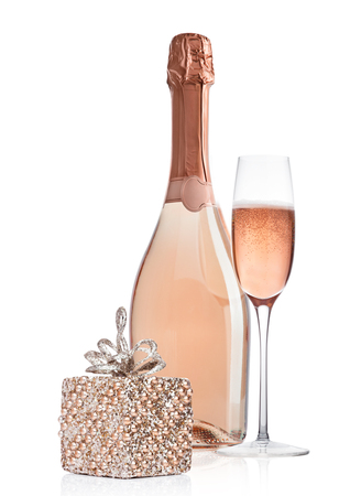 Photo for Bottle and glass of pink rose champagne with christmas decoration and gift on white background - Royalty Free Image