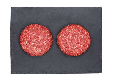 Photo pour Raw fresh beef burgers on stone plate on white background - image libre de droit