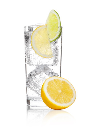 Photo for Glass of sparkling water soda drink lemonade with ice and lime lemon slice on white background - Royalty Free Image