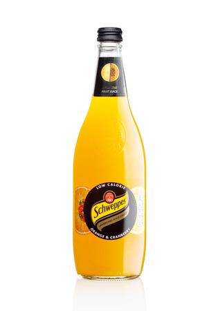 Foto de LONDON, UK -DECEMBER 07, 2017: Bottle of Schweppes orange juice sparkling drink on white background. - Imagen libre de derechos