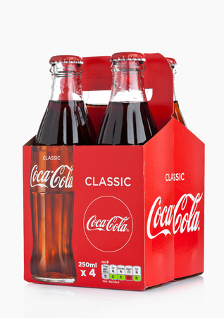 Foto de LONDON, UK -DECEMBER 07, 2017: Bottles pack of Classic Coca-Cola on white Background. Coca-Cola is one of the most popular soda products in the world. - Imagen libre de derechos