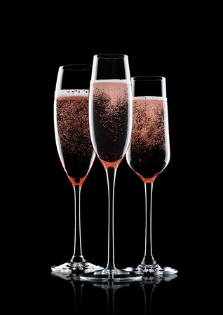 Photo for Rose pink champagne glasses with bubbles on black background with reflection - Royalty Free Image