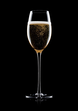 Photo for Elegant glass of yellow champagne with bubbles on black background with reflection - Royalty Free Image