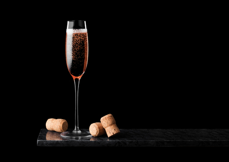 Photo for Elegant glass of pink rose champagne with cork on black marble board on black - Royalty Free Image