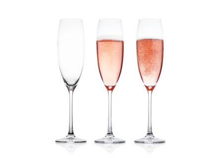 Photo for Elegant Rose pink champagne glasses with bubbles  on white background with reflection - Royalty Free Image