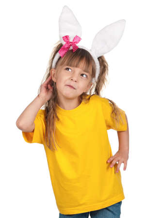 Portrait of happy little girl with bunny ears over white background