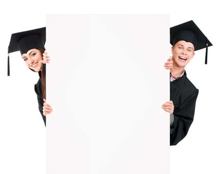 Graduate students in mantle showing blank placard board, isolated on white background