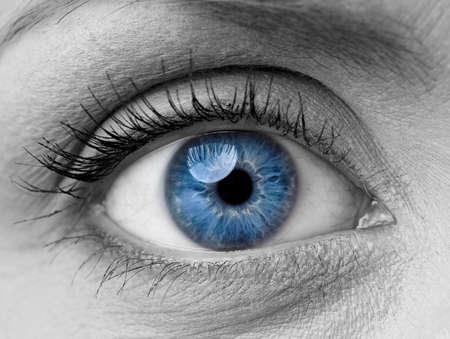 Foto de Beautiful blue woman single eye close up, black and white - Imagen libre de derechos