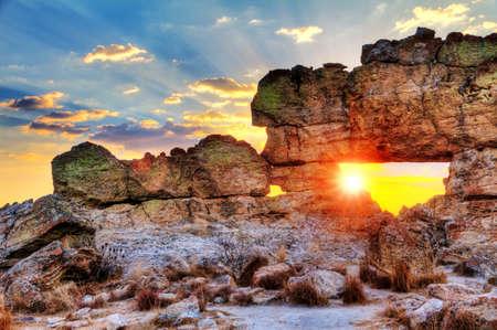 Foto de Sunset at the famous rock formation  La Fenetre  near Isalo, Madagascar  HDR - Imagen libre de derechos