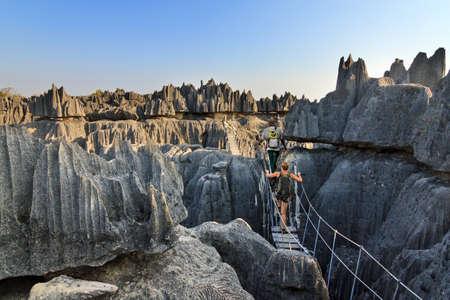 Foto de Beautiful tourist on an excursion in the unique limestone landscape at the Tsingy de Bemaraha Strict Nature Reserve in Madagascar - Imagen libre de derechos
