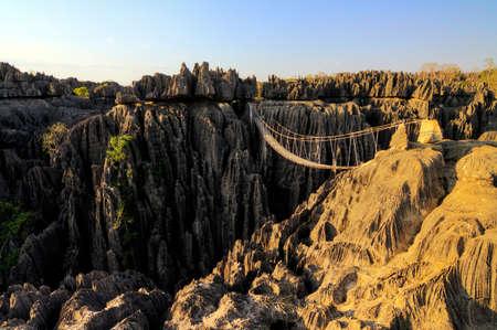 Foto de Beautiful HDR view on the bridge over the canyon at the Tsingy de Bemaraha Strict Nature Reserve in Madagascar - Imagen libre de derechos
