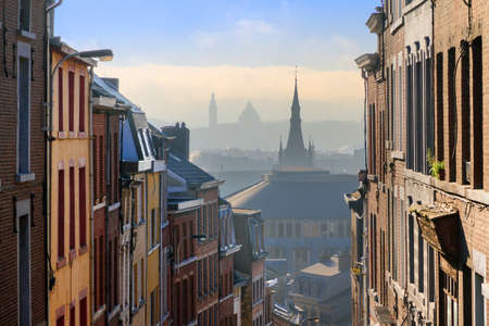Photo for Beautiful urban cityscape see through with a view over Liege, Belgium, from one of the street leading up the hill on a sunny winter morning - Royalty Free Image