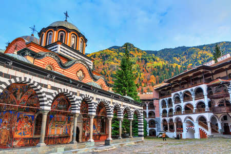 Photo for Beautiful view of the Orthodox Rila Monastery, a famous tourist attraction and cultural heritage monument in the Rila Nature Park mountains in Bulgaria - Royalty Free Image