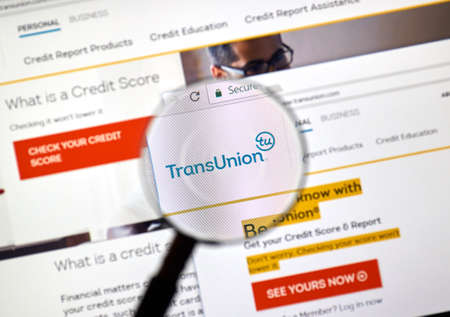 Photo pour MONTREAL, CANADA - MARCH 10, 2018: Transunion web site under magnifying glass. TransUnion is a consumer credit reporting agency, it collects information on over one billion individual consumers. - image libre de droit