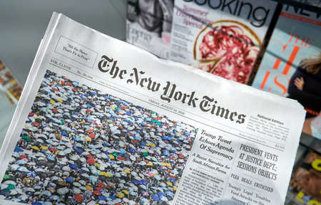 Foto für MIAMI, USA - AUGUST 22, 2018: The New York Times newspaper in a hand. The New York Times is a popular American newspaper based in New York City with worldwide influence - Lizenzfreies Bild