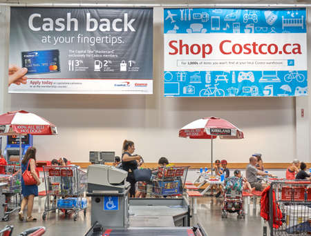 Photo for TORONTO, CANADA - AUGUST 15, 2018: Advertisement banners on Costco payment card in a Costco store. Costco, is an American corporation which operates a chain of membership-only warehouse clubs. - Royalty Free Image