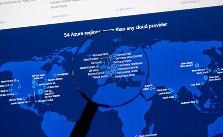 Foto de MONTREAL, CANADA - JANUARY 10, 2019: Microsoft Azure regions map on a pc screen under magnifying glass. Microsoft Azure is a cloud computing service created by Microsoft. - Imagen libre de derechos