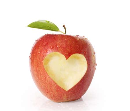 Foto de apple with heart shape Isolated on white  - Imagen libre de derechos