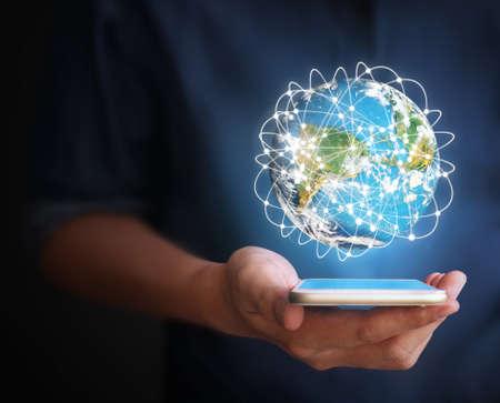 Foto de Touch screen smartphone in hand - Imagen libre de derechos