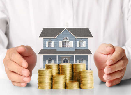 Photo for Mortgage concept by money house from the coins - Royalty Free Image