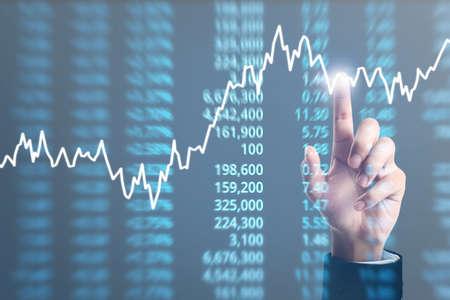 Foto de Analysing illustrated chart stock market financial data on a screen - Imagen libre de derechos