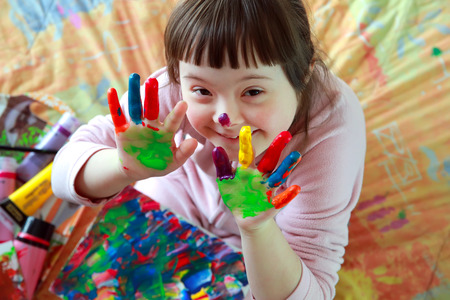 Photo for Cute little girl with painted hands - Royalty Free Image