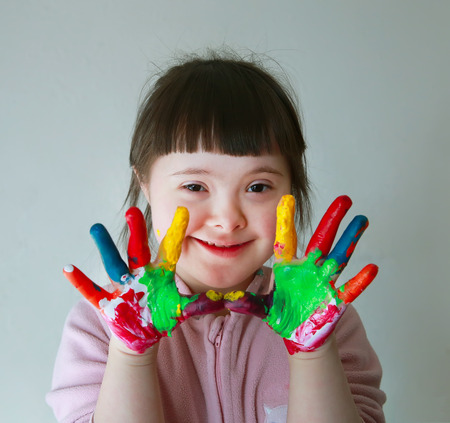 Photo for Cute little girl with painted hands. Isolated on grey background. - Royalty Free Image