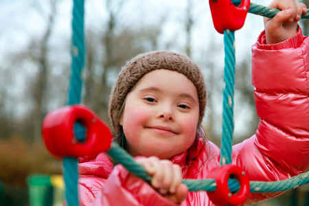 Foto de Portrait of beautiful girl on the playground - Imagen libre de derechos