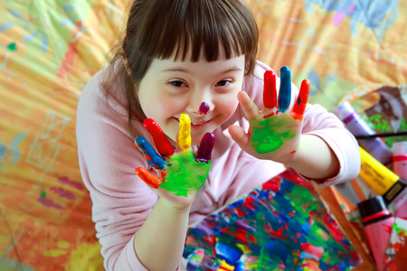Foto de Cute little girl with painted hands - Imagen libre de derechos