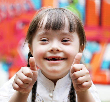 Foto de Portrait of beautiful happy girl giving thumbs up. - Imagen libre de derechos
