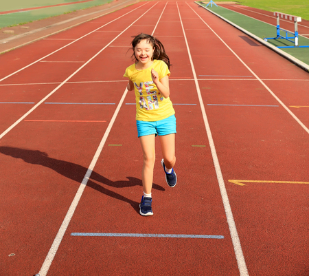 Foto de Disabled girl have fun on the stadium - Imagen libre de derechos