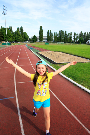 Photo for Little girl have fun on the stadium - Royalty Free Image