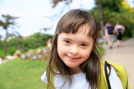 Foto de Portrait of little girl smiling outside - Imagen libre de derechos